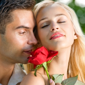Young happy couple with rose, outdoor